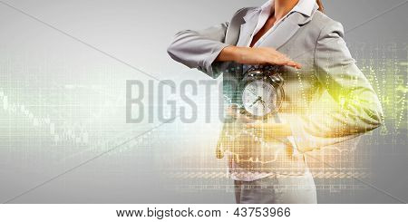 Business woman holding alarmclock