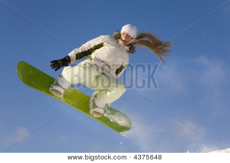 Young Woman Snowboarder Flying