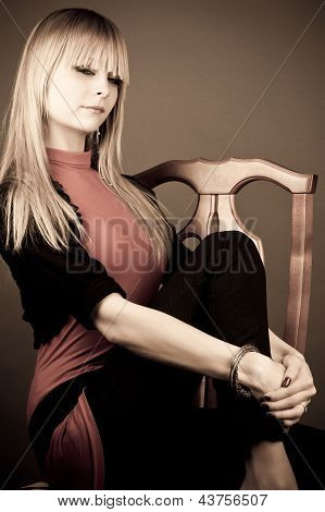 blond woman sitting on a chair