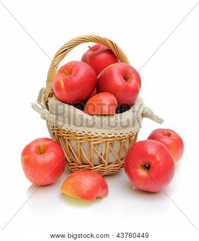 Red Apples In A Basket On A White Background