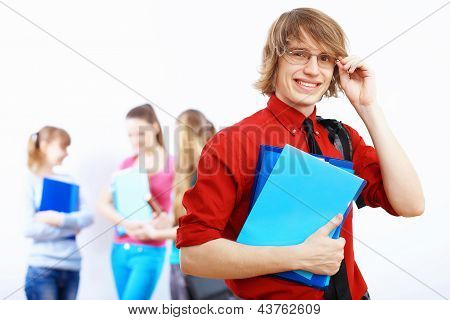 Student in red shirt with books