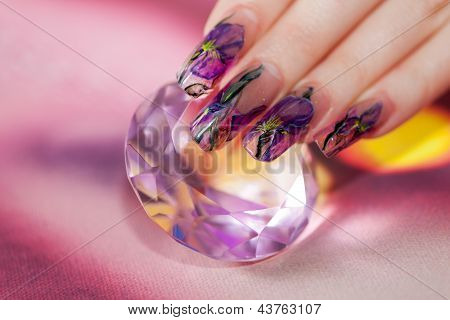 Fingers With  Beautiful Manicure Touch A Shining Diamond