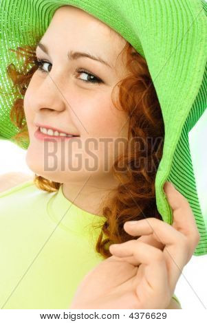 Happy Young Woman Wearing A Green Hat