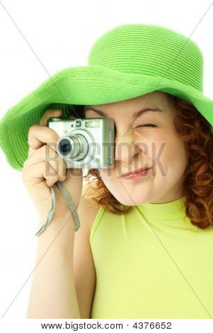 Enthusiastic Young Woman With A Camera