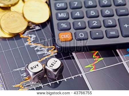 Dices Cubes With The Words Sell Buy, Calculator And Golden Coins. Financial Chart As Background. Sel