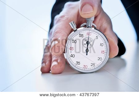 Human hand showing a stopwatch