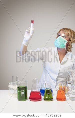 Female Laboratory Worker Experimenting