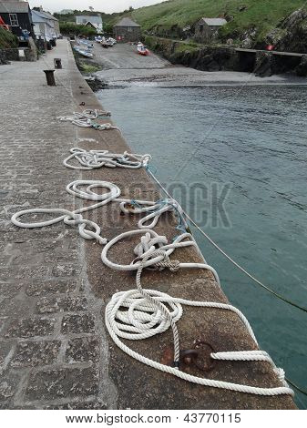 Harbor Wall Seascape With Ropes