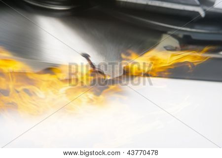 Blade Of A Saw In Fire. Composite Image. Closeup