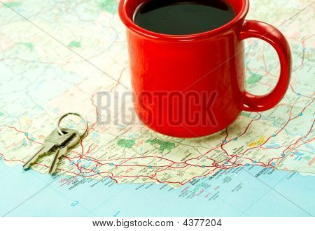 Red Coffee Mug And Car Keys On Map