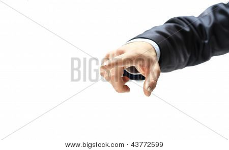 Businessman's hand pointing on something down