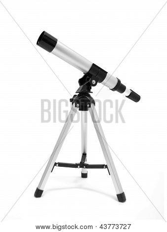 Telescope on tripod over white