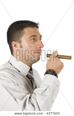 Portrait Of Young Businessman With Cigar