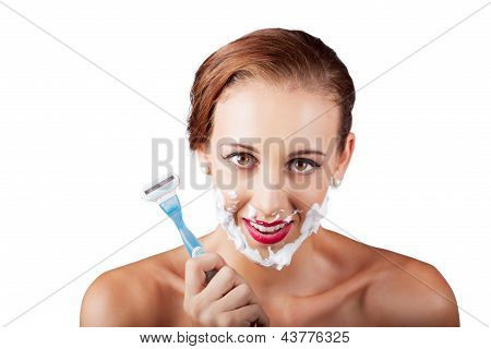 Funny Portrait Of A Woman Shaving Face With Razor