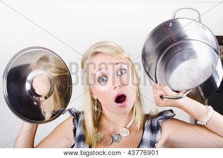 Shocked Caucasian Woman Holding Empty Cooking Pot