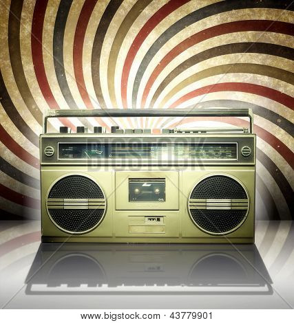Vintage stereo player in spiral decor background.