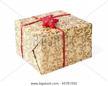 Golden gift box with red ribbon and star