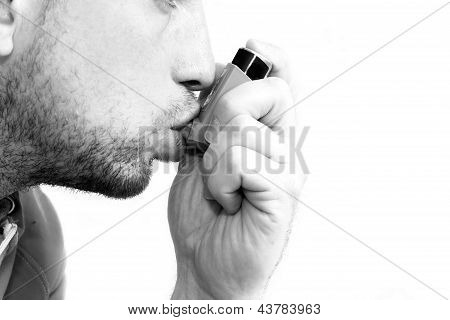 Man Inhaling His Asthma Pump