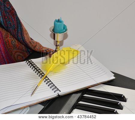 Still Life With A Notebook And A Feather On A Synthesizer