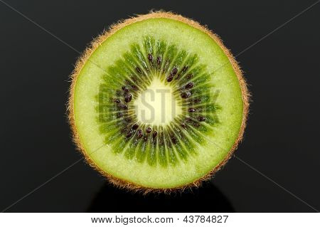 Kiwi Fruit Cross Section On Black Background