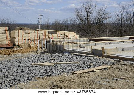 Wood By A Cement Foundation For A New Home Construction
