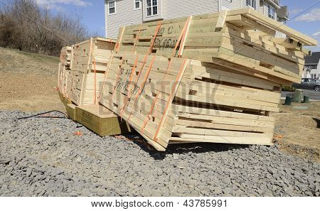 Stack Of New Lumber Ready For A New Home Construction