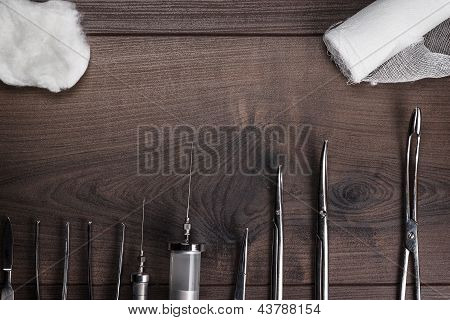 surgical armaments on wooden background