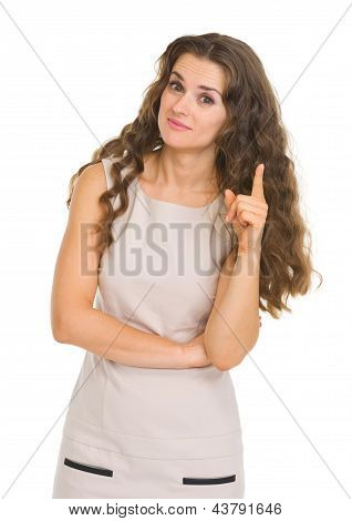 Portrait Of Interested Young Woman Pointing On Fact