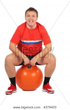 Man Sitting On A Fitness Sphere.