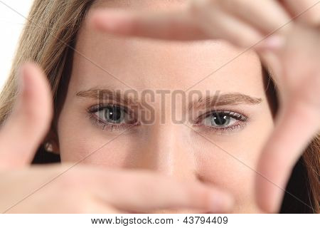Beautiful Woman Framing Her Blue Eyes With The Fingers