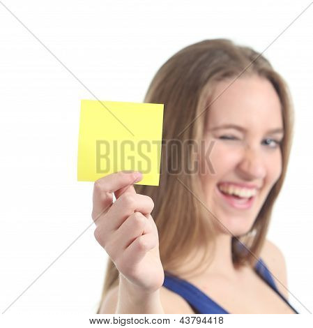 Woman Winking And Showing A Blank Yellow Paper Note