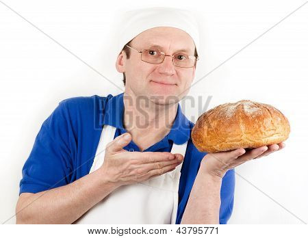 Male cook in uniform and hat with bread