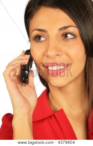 Woman Calling On A Cell Phone. Close- Up