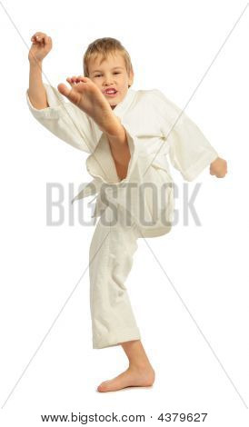 Karate Boy Kicking By A Left Leg