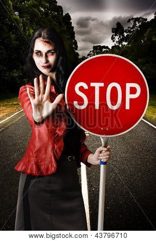 Zombie Girl Holding Stop Sign At Dead End