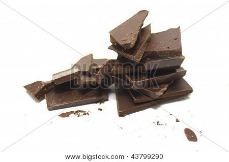 Broken chocolate bar on a white