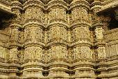picture of kandariya mahadeva temple  - Sculptures of religious figures decorating the ancient Kandariya Mahadeva Hindu Temple at Khajuraho Uttar Pradesh India - JPG