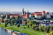 stock photo of castle  - Historic royal Wawel castle in Cracow Poland with park and Vistula river - JPG