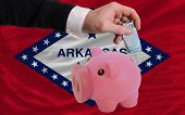 Funding Euro Into Piggy Rich Bank Flag Of American State Of Arkansas