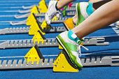 stock photo of sprinter  - female sprinters track and field  starting the race - JPG