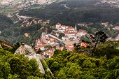 stock photo of chimney rock  - Aerial View on Sintra National Palace from Murish Castle near Lisbon in Portugal - JPG