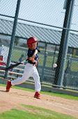 stock photo of little-league  - Youth little league baseball boy swinging the bat - JPG