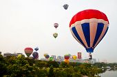 PUTRAJAYA, MALAYSIA - MARCH 2013 - Hot air balloons take off at the annual Hot Air Balloon Fiesta on