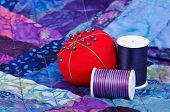 picture of quilt  - Quilting thread and pincushion on the top of the quilt - JPG