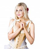 picture of heartfelt  - Smiling blond pinup woman wearing lacy sexy corselet dress tied with bows on white background - JPG