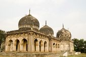 stock photo of mughal  - Some of the historic Qutub Shahi Tombs built during the Mughal Empire in Golconda - JPG