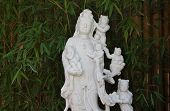 Guan Yin With Childran At Bambo Tree In The Garden.