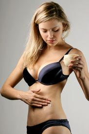 image of body-lotion  - a blonde woman with a body lotion - JPG
