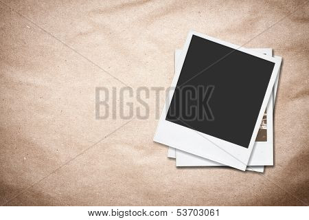 Blank Photo Frames On Old Paper Background.