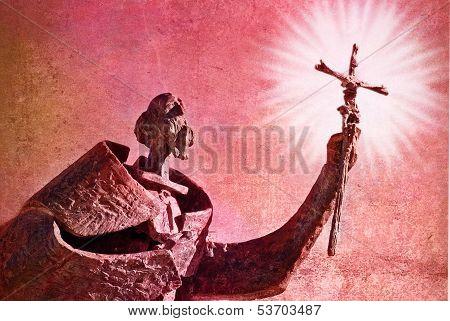 Statue hand holding  christian crucifix